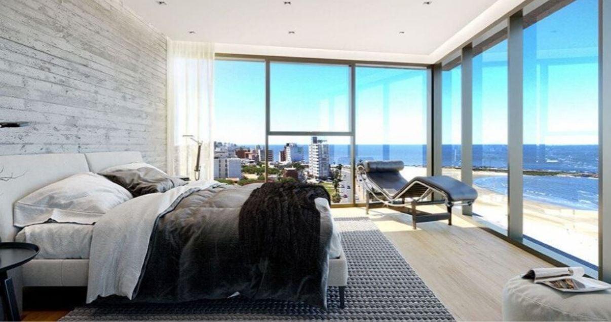 Render del interior de una habitación de Torre arenas con vista al mar