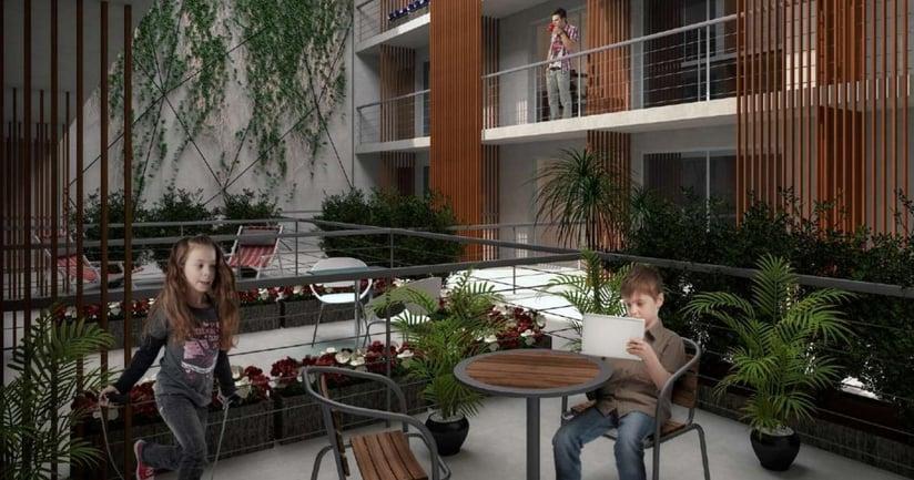 Interior de edificio jardin con niños divirtiendose Neo Buxareo