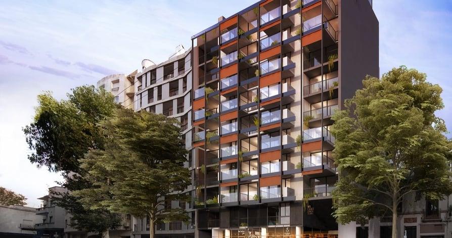 Exterior del moderno edificio 01 Del Centro con balcones vidriados en Montevideo de la desarrolladora inmobiliaria Vitrium Capital