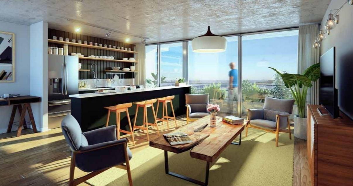 Interior de un apartamento en el edificio 01 Las Artes de la desarrolladora inmobiliaria Vitrium Capital en Montevideo con barra alta y buena decoración