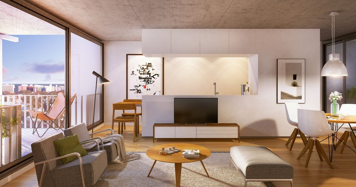 Interior de un livin en el edificio 01 Del Centro con sillones y colores cálidos de la desarrolladora inmobiliaria Vitrium Capital