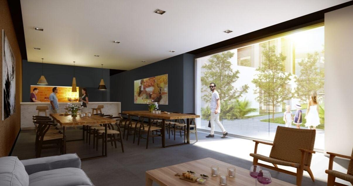 Salon de usos multiples del moderno edificio Bilú Riviera de la desarrolladora inmobiliaria Altius Group