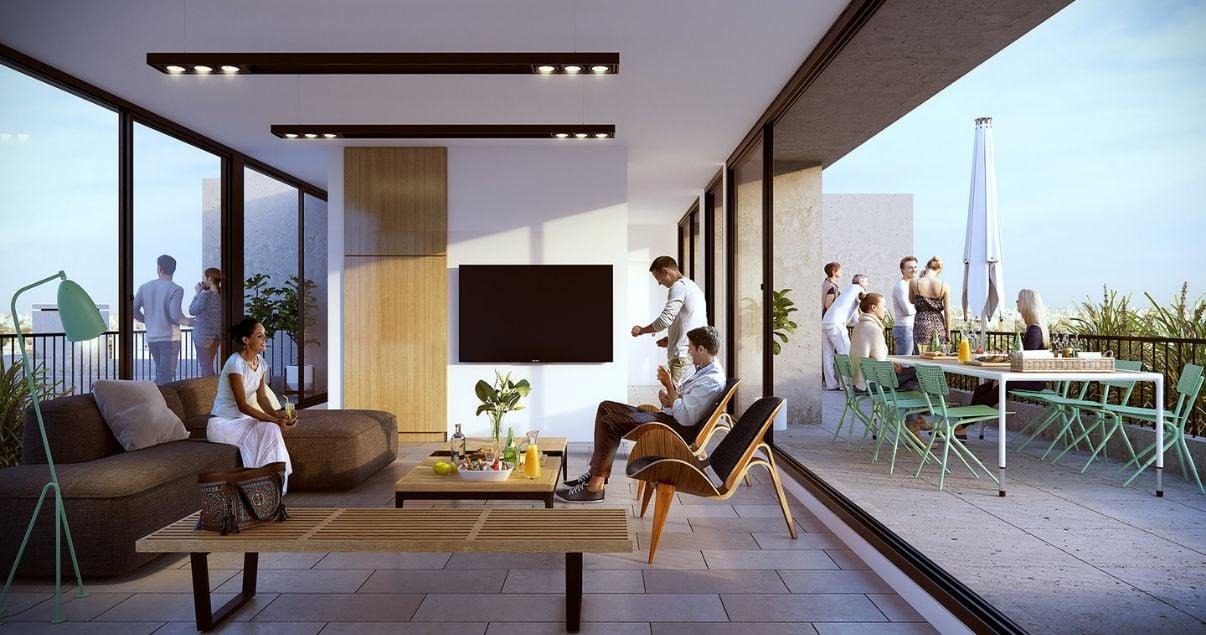 Interiror del salon de usos multiples con sillones y terraza en el edificio Dómini Rivera y Salterain del estudio de arquitectos Pablo Szames